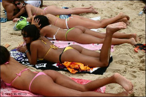 girls in bikinis on beach in Brazil